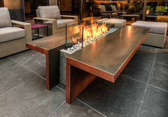 Behind a Glass Wall Outdoor Fireplace Idea