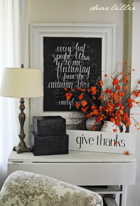 Black and White Mantel Decor with Studding Red Foliage Accent