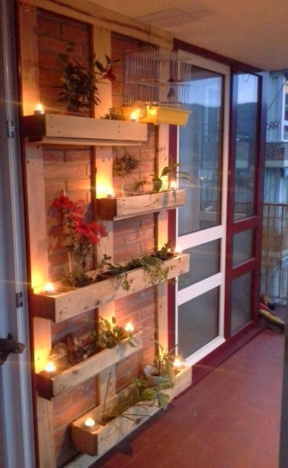 The Subtle Glow of Candles Lights Up These Wood Plant Holders