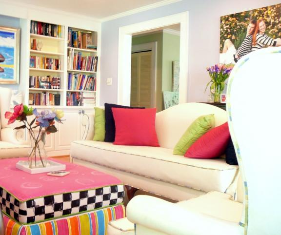 Vibrant library setting with hand painted ottoman