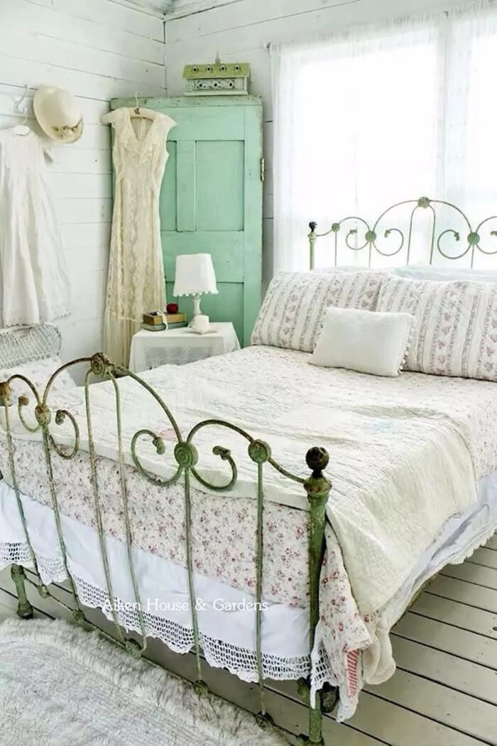 Rustic Brass Bedframe With A Light And Airy Color Scheme